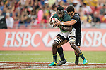 Tone Ng Shiu of New Zealand (right) competes with Tim Agaba of South Africa (left) for the ball during the match South Africa vs New Zealand, Day 2 of the HSBC Singapore Rugby Sevens as part of the World Rugby HSBC World Rugby Sevens Series 2016-17 at the National Stadium on 16 April 2017 in Singapore. Photo by Victor Fraile / Power Sport Images