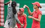 TAOYUAN, TAIWAN - OCTOBER 28:  Suzann Pettersen of Norway is sprayed by Michelle Wie after winning the Sunrise LPGA Taiwan Championship at the Sunrise Golf Course on October 28, 2012 in Taoyuan, Taiwan.  Photo by Victor Fraile / The Power of Sport Images