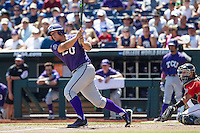 TCU Horned Frogs designated hitter Luken Baker (19) follows through on his swing against the Texas Tech Red Raiders in Game 3 of the NCAA College World Series on June 19, 2016 at TD Ameritrade Park in Omaha, Nebraska. TCU defeated Texas Tech 5-3. (Andrew Woolley/Four Seam Images)