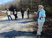 Jane Hetzel of Bella Vista, an organizer with The NWA Hiking Group, speaks Wednesday, Nov. 18, 2020, with other members of the group before setting out on a hike around Lincoln Lake in Lincoln. The group is made up of hiking enthusiasts from around Northwest Arkansas as well as Fort Smith, Tulsa, Okla., Joplin, Mo., and Springfield, Mo. and meets for frequent hikes and paddles at various places around the area. Visit nwaonline.com/201119Daily/ for today's photo gallery. <br /> (NWA Democrat-Gazette/Andy Shupe)