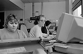 Admin staff in the computerised telephone exchange at Ealing Hospital, West London.