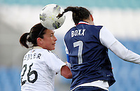 US's Shannon Boxx heads the ball next Germany's Nadine Kebler during their Algarve Women's Cup soccer match at Algarve stadium in Faro, March 13, 2013.  .Paulo Cordeiro/ISI
