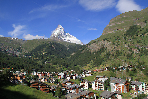 Switzerland, Matterhorn.  <br /> When you visit the mountains, it's worth knowing something about the local weather. A common pattern is to wake-up to clear skies. As the day progresses, clouds form and afternoon thunderstorms can produce rain and lightning.<br /> Starting fairly early in Zermatt on the Gornergrat train, with the Matterhorn behind, Switzerland.