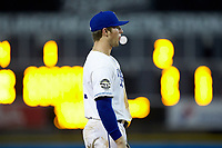 Burlington Royals third baseman Jake Means (9) blows a bubble while on defense during the game against the Danville Braves at Burlington Athletic Stadium on July 13, 2019 in Burlington, North Carolina. The Royals defeated the Braves 5-2. (Brian Westerholt/Four Seam Images)
