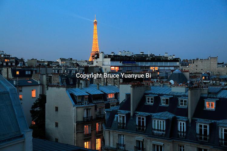 The night view of Eiffel Tower La tour eiffel over residential buildings.City of Paris. Paris. France