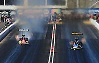 Oct. 15, 2011; Chandler, AZ, USA; NHRA top fuel dragster driver Cory McClenathan (right) races alongside Spencer Massey during qualifying at the Arizona Nationals at Firebird International Raceway. Mandatory Credit: Mark J. Rebilas-