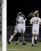 """Boston College forward Brooke Knowlton (16) celebrates goal with Boston College forward Natalie Crutchfield (9). Boston College defeated West Virginia, 4-0, in NCAA tournament """"Sweet 16"""" match at Newton Soccer Field, Newton, MA."""