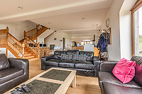 BNPS.co.uk (01202 558833)<br /> Pic: PurpleBricks/BNPS<br /> <br /> Pictured: A lounge room.<br /> <br /> A luxury ten-bedroom eco-home has gone on sale for offers in excess of £850,000 - the same price as a one-bedroom flat in Chelsea.<br /> <br /> The new owner will buy the chance to become an eco-laird, as the property can be run entirely off-grid and includes four lochs and 38 acres of land which could potentially be re-wilded.<br /> <br /> Leadburn Manor at West Linton is just 12 miles south of Edinburgh in Scotland, but looks out over open countryside.