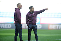 Mike van der Hoorn (left) and Martin Olsson (right) of Swansea City arrive for during the Sky Bet Championship match between Bolton Wanderers and Swansea City at the Macron Stadium in Bolton, England, UK. Saturday 10 November 2018