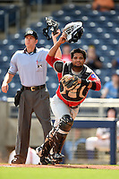 Frisco Rough Riders catcher Tomas Telis (13) and umpire Travis Eggert during the first game of a doubleheader against the Tulsa Drillers on May 29, 2014 at ONEOK Field in Tulsa, Oklahoma.  Frisco defeated Tulsa 13-4.  (Mike Janes/Four Seam Images)