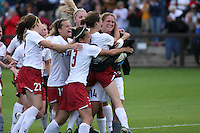 18 November 2007: Allison McCann, Kristin Stannard, Ali Riley, Allison Falk, and Kelley O'Hara congratulate Alex Gamble during Stanford's 1-1 double overtime shootout win over California in the second round of the NCAA Division 1 Women's Soccer Championships at Laird Q. Cagan Stadium in Stanford, CA.