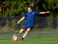 KASHIMA, JAPAN - AUGUST 4: Emily Sonnett #14 of the USWNT crosses the ball during a training session at the practice field on August 4, 2021 in Kashima, Japan.