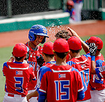 ABERDEEN, MD - AUGUST 02: Peter Vazquez #12 of Puerto Rico gets water thrown in his face by Marhlon Torres #3 of Puerto Rico after hitting his 2nd home run of the game in the 3rd inning during a game between the Dominican Republic and Puerto Rico during the Cal Ripken World Series at The Ripken Experience Powered by Under Armour on August 2, 2016 in Aberdeen, Maryland. (Photo by Ripken Baseball/Eclipse Sportswire/Getty Images)