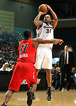 Reno Bighorns Antoine Wright shoots over Idaho Stampede's Marcus Banks during a basketball game Sunday, April 1, 2012 in Reno, Nev. Idaho won 108-99..Photo by Cathleen Allison