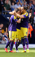 Pictured L-R: Pablo Hernandez of Swansea celebrating his goal with team mates Chico Flores and Jose Canas.<br /> Sunday 01 September 2013<br /> Re: Barclay's Premier League, West Bromwich Albion v Swansea City FC at The Hawthorns, Birmingham, UK.
