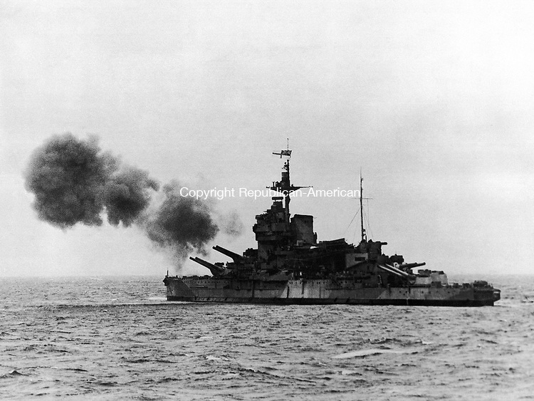 On board the Captain Class Frigate H.M.S. Holmes when she formed part of the escort to the Navy's big ships off Le Havre during their bombardment of enemy positions on the Normandy Coast on June 6, 1944. The 15-inch guns of the war ship shelling German invasion coast positions is shown. (AP Photo)