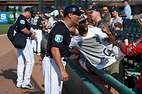 Detroit Tigers coach Omar Vizquel (13) takes photos with fans after an exhibition game against the Florida Southern Moccasins on February 29, 2016 at Joker Marchant Stadium in Lakeland, Florida.  Detroit defeated Florida Southern 7-2.  (Mike Janes/Four Seam Images)