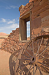 Glen Canyon National Recreation Area, AZ / APR.A wheel rests against the stone walls of what remains of the Lees Ferry Fort near Glen and Marble canyons