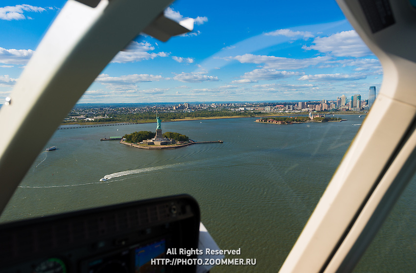 Statue of Liberty and Hudson river view from the window of helicopter, New York