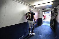 Dec. 20, 2015. San Diego,  CA. USA.|Philip Rivers pauses for a moment before entering the field for Chargers vs Dolphins game at the Q. |Photos by Jamie Scott Lytle. Copyright.