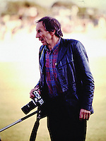 Photographer Peter Bush roves the sideline during the All Blacks trial at the Oval in Palmerston North, New Zealand in 1988. Photo: Dave Lintott / lintottphoto.co.nz