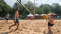 Craig Davidson (right) dives to make a save Sunday Sept. 5, 2021 while playing volleyball during a tournament hosted by the Ozark Volleyball Club at Veterans Park in Fayetteville. The two-day event is the club's largest event of the year. Davidson and his teammate Cody Sanders were competing against John Hamilton (left) and Jon Mesko. For more information about the club see https://www.ozarkvolleyball.org/#/  Visit nwaonline.com/210000906Daily/  (NWA Democrat-Gazette/J.T. Wampler)