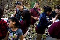 Jennifer Klein leads sixth grade students from Roger Williams Middle School in Providence, Rhode Island, as they walk along a trail at the Powder Mill Ledges Wildlife Refuge in Smithfield, Rhode Island, on Oct. 20, 2011. The students are part of the EcoExplorer program run by the Providence After School Alliance, which helps to kids in learning environments outside of school time.  <br /> The students make a weekly visit to the refuge, operated by the Rhode Island Audubon Society, to learn about nature and ecology. Klein is an Urban Education Coordinator for the Rhode Island Audubon Society.<br /> <br /> M. Scott Brauer for Education Week