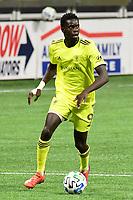 ATLANTA, GA - AUGUST 22: Dominique Badji #9 dribbles the ball during a game between Nashville SC and Atlanta United FC at Mercedes-Benz Stadium on August 22, 2020 in Atlanta, Georgia.