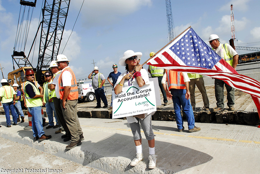 Mary Burns, a resident of Lakeview, protests at the 17th Street Canal during a memorial for the first anniversary of Hurricane Katrina, New Orleans, Tuesday, Aug. 29, 2006..(AP Photo/Cheryl Gerber).