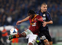 Calcio, Serie A: Roma vs Inter. Roma, stadio Olimpico, 1 marzo 2014.<br /> AS Roma forward Gervinho, of Ivory Coast, left, is challenged by FC Inter defender Walter Samuel, of Argentina, during the Italian Serie A football match between AS Roma and FC Inter at Rome's Olympic stadium, 1 March 2014.<br /> UPDATE IMAGES PRESS/Riccardo De Luca