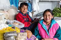 Peru, Cusco, San Pedro Market.  Brother and Sister.
