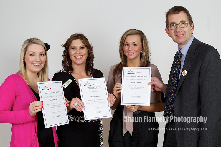 Pix: Shaun Flannery/shaunflanneryphotography.com...COPYRIGHT PICTURE>>SHAUN FLANNERY>01302-570814>>07778315553>>..31st March 2011..............Doncaster Metropolitan Borough Council (DMBC) Annual Apprenticeship Framework Award Ceremony, The Keepmoat Stadium..L-R Sophie Baker, Apprentice of the Year 2010/11, Dulcie Aulton, Apprentice Programme Line Manager of the Year 2010/11, Sarah Edwards, Advanced Apprentice of the Year 2010/11 with Rob Vincent, Chief Executive.