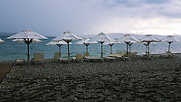WEATHER PICTURE<br />Empty beach umbrellas and sun beds during a monsoon type storm at Nireas beach near Aliveri on the island of Evia, Greece. The country has been experiencing recent heatwaves. Thursday 27 July 2017