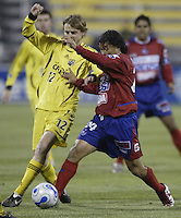 08 November 2006: CSD Municipal's Sergio Guevara, right, and Columbus Crew's Eddie Gaven chase a loose ball during the first half in Columbus, Ohio.<br />