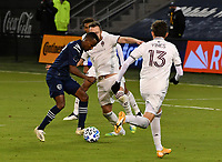 KANSAS CITY, KS - OCTOBER 24: #17 Gadi Kinda of Sporting Kansas City attempts a shot on goal as #9 Nicolas Benezet and #13 Sam Vines of the Colorado Rapids try to stop him during a game between Colorado Rapids and Sporting Kansas City at Children's Mercy Park on October 24, 2020 in Kansas City, Kansas.