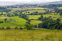 Cumbria, England, UK.  View to the South from Banks East Turret on Hadrian's Wall Footpath.  Low Row village in the distance, far right.