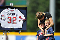 The Greenville Drive on Sunday retired jersey number 32 in honor of Greenville Police Officer Allen Jacobs, who was killed in the line of duty earlier this year. Jacobs' widow, Meghan, stands next to the jersey with their sons. Number 32 was Jacobs' call number with the department. (Tom Priddy/Four Seam Images)