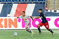 FOXBOROUGH, MA - AUGUST 29: Kaku #10 of New York Red Bulls looks to pass as Brandon Bye #15 of New England Revolution closes during a game between New York Red Bulls and New England Revolution at Gillette Stadium on August 29, 2020 in Foxborough, Massachusetts.