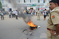 Pictured: Police officers watch on a tyre burns.<br />  Re: Activists of the Congress political party clash with police in protest against price rises in oil, gas and other daily commmodities by BJP government in Agartala, in the Tripura area of India. Monday 10 September 2018