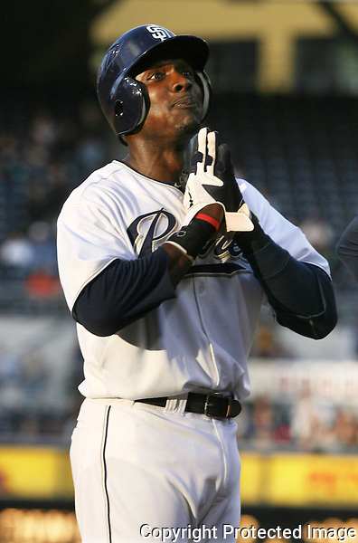 Padres' Orlando Hudson jestures with a prayer while on 3rd  base during the Giants' pitching change in the bottom of the 9th inning in 2011.  photo for North County Times