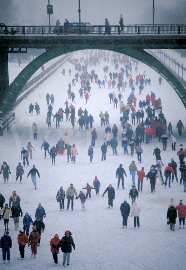 Winter scene. Enthusiastic skaters meet on the frozen Rideau Canal in Ottawa, Canada during the Winterlude festival. Ottawa is the capital of Canada and is in Southeastern Ontario. Ottawa, Canada.
