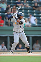Designated hitter Bo Thompson (38) of the Charleston RiverDogs bats in a game against the Greenville Drive on Friday, August 14, 2015, at Fluor Field at the West End in Greenville, South Carolina. Charleston won 6-2. (Tom Priddy/Four Seam Images)