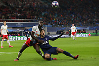 Dayot Upamecano of RB Leipzig and Erik Lamela of Tottenham Hotspur during RB Leipzig vs Tottenham Hotspur, UEFA Champions League Football at the Red Bull Arena on 10th March 2020