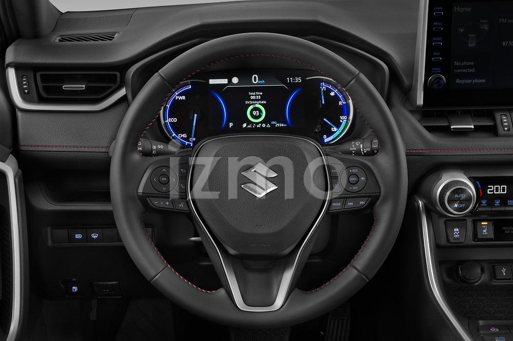 Car pictures of steering wheel view of a 2021 Suzuki Across GLX 5 Door SUV Steering Wheel