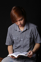 MODEL RELEASED - Asian (Filipino) 17 years old male teenager<br /> with a book