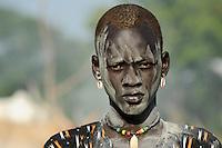 SOUTH SUDAN Bahr al Ghazal region , Lakes State, village Yeri cattle camp near Rumbek, with ash smeared Dinka warrior with Zebu cow / SUED-SUDAN  Bahr el Ghazal region , Lakes State, Dorf Yeri, mit Asche beschmierte Dinka Krieger mit Zebu Rindern im cattle camp bei Rumbek