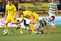 Celtic's Thomson challenges Cristian Galas.