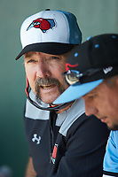Texas Rangers minor league pitching consultant Bryan Harvey (left) chats with Hickory Crawdads pitching coach Jose Jaimes (right) during the game against the Kannapolis Intimidators at Kannapolis Intimidators Stadium on June 2, 2019 in Kannapolis, North Carolina. The Intimidators defeated the Crawdads 4-3. (Brian Westerholt/Four Seam Images)