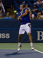 Xavier Malisse hits a backhand during the Legg Mason Tennis Classic at the William H.G. FitzGerald Tennis Center in Washington, DC.  Unseeded Xavier Malisse defeated American John Isner in three sets in a thunderstorm delayed evening session.