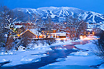 The glowing lights along the Yampa river in downtown Steamboat springs Colorado after a fresh blanket of snow.